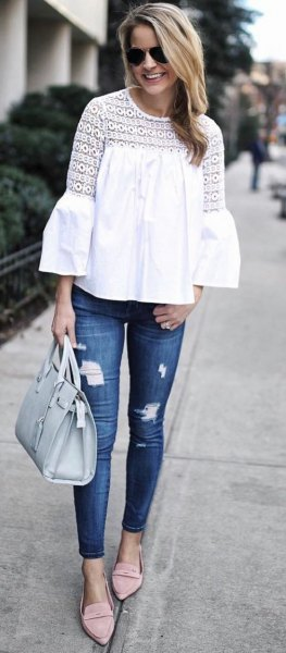 watch sleeve white top ripped skinny jeans