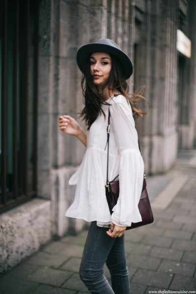 white watch sleeve top black felt hat