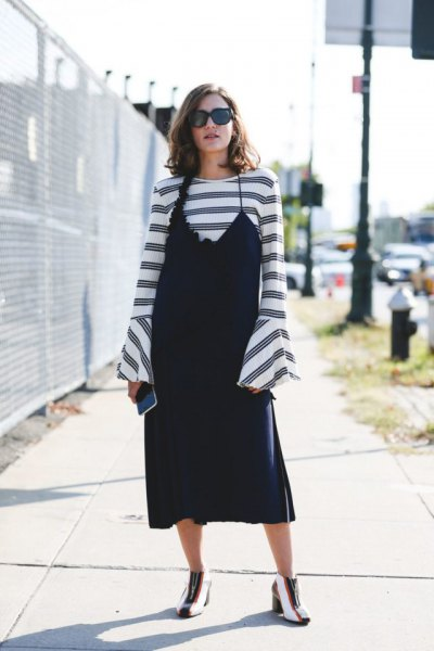 black slip dress over striped watch sleeve top