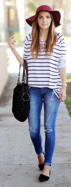 navy and white striped t-shirt black floppy hat