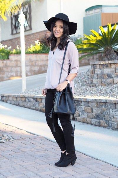 gray blouse black skinny jeans