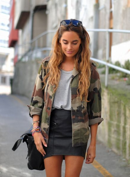 camo jacket gray t shirt black leather skirt