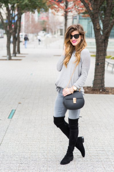 gray sweater jeans high boots