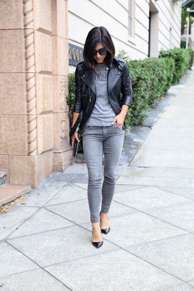 gray t-shirt black leather jacket gray jeans
