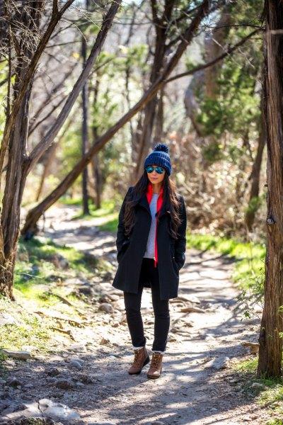 brown hiking shoe black wool coat