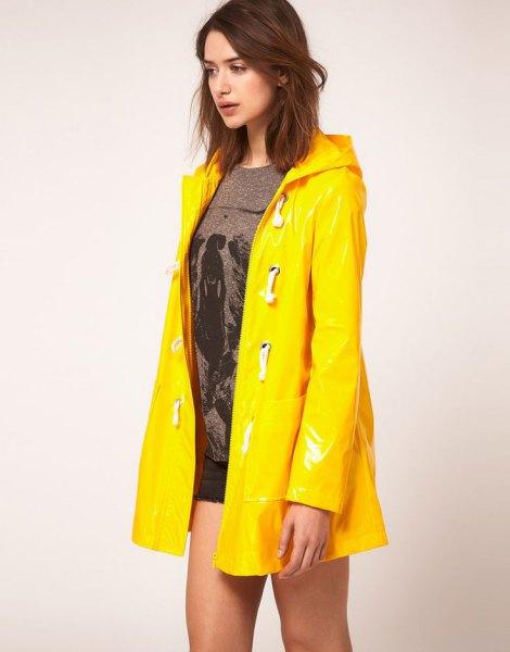 yellow raincoat gray knitted sweater denim shorts