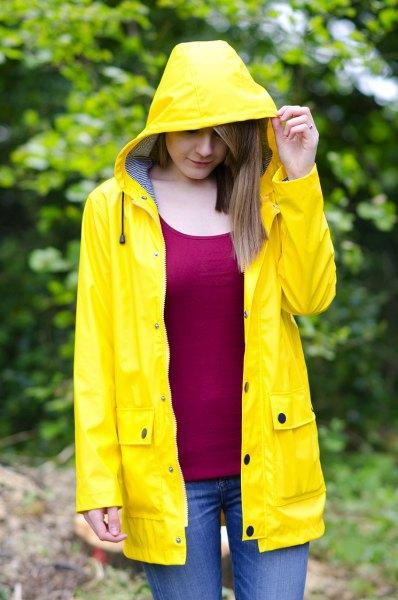 red vest top yellow raincoat jeans