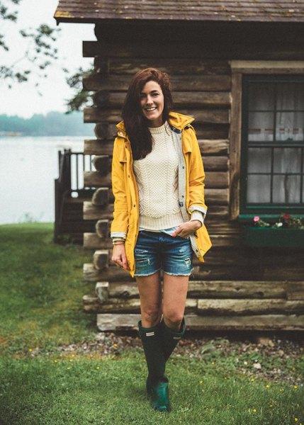 yellow raincoat white knitted sweater