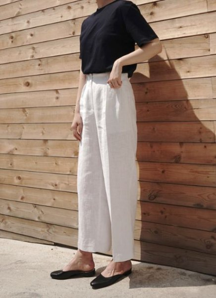 white black top with high waist in linen trousers
