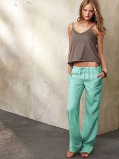 forest green vest top with low waist linen trousers