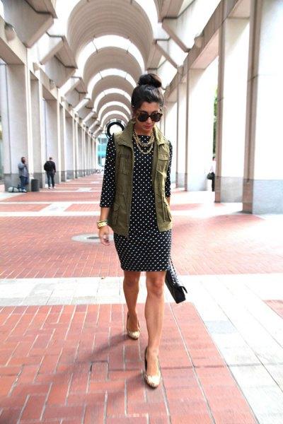loading vest over black and white polka dot dress