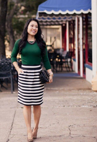 forest green sweater black and white striped skirt
