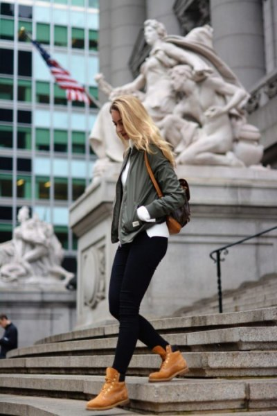 bomber jacket black jeans timberland boots outfit
