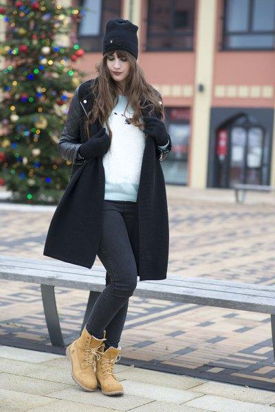 black trench coat white sweater timberland