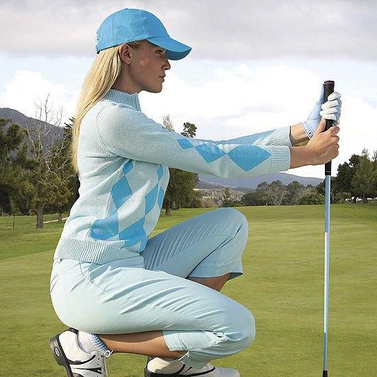light blue golf pants white sweater baseball cap