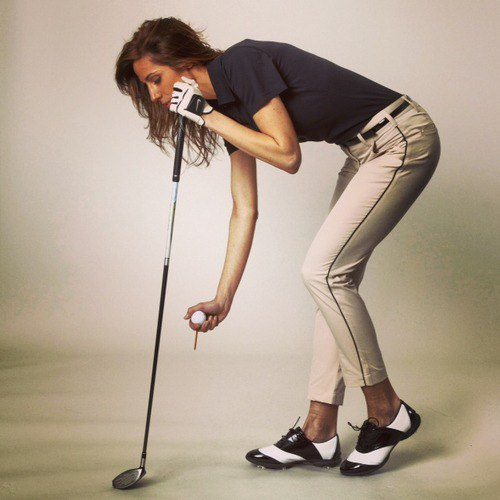 khaki golf pants with black polo shirt