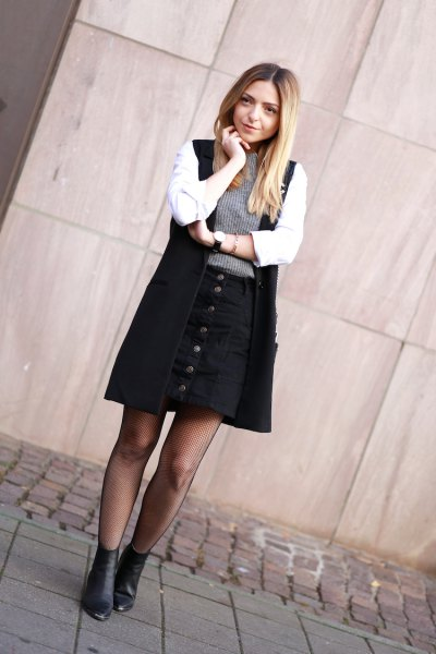 white shirt black long vest and button up skirt