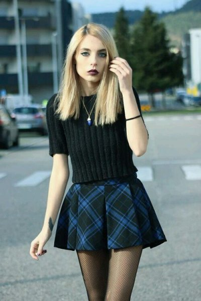 black knitted sweater with plaid mini flare skirt