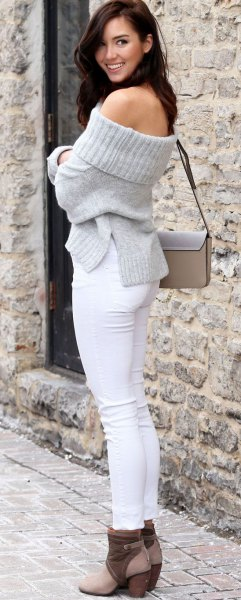 gray of shoulder knit sweater white skinny jeans