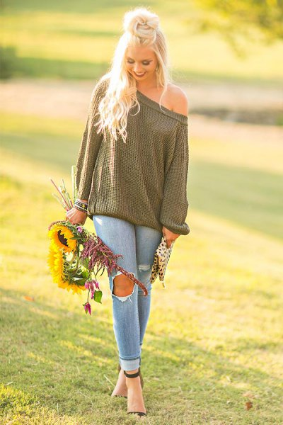 green of shoulder knit sweater ripped jeans