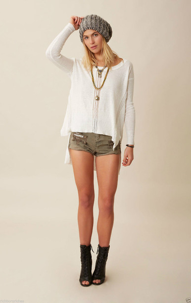 white sweater khaki shorts open toe boots