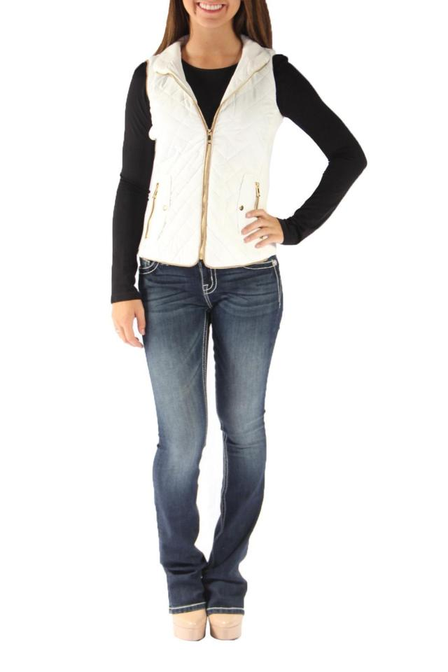 cream quilted vest over black