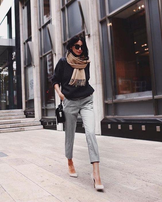 black sweater gray chinos