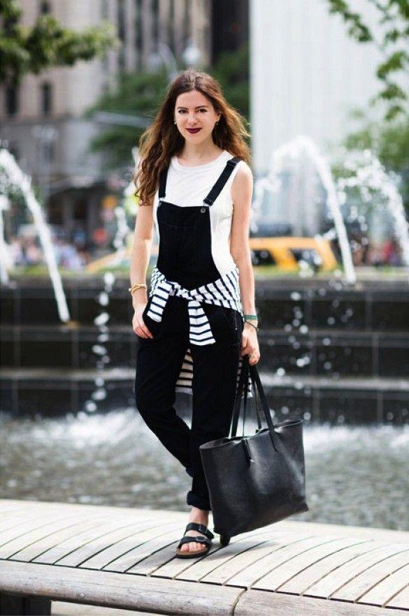black overalls striped tee around the waist