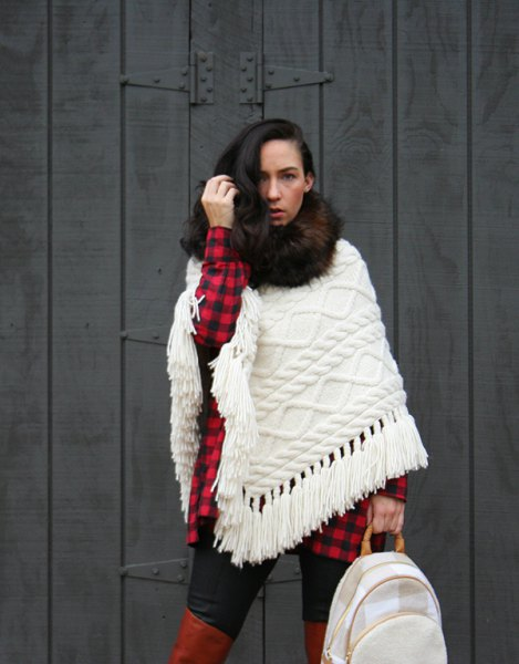 white cable knit scarf with red and black checked tunic shirt