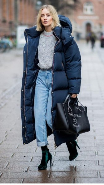black long puffer skirt with gray sweater and mom jeans