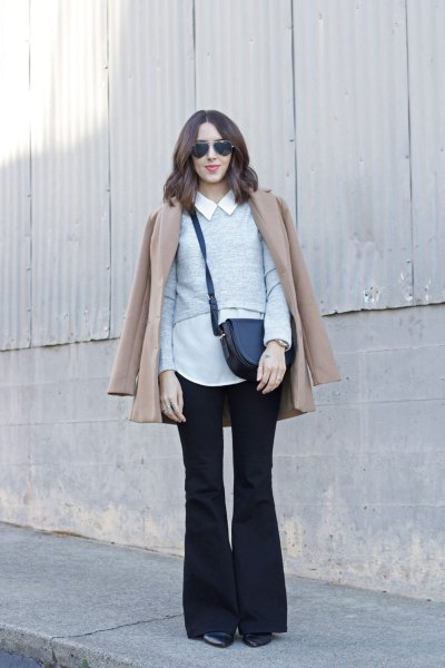 white collar shirt with a blushing pink coat and black flared jeans