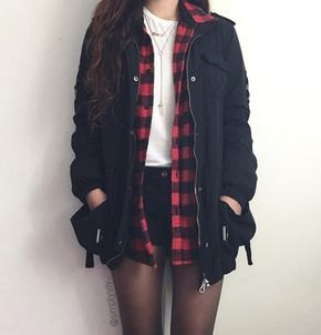 black tool jacket with white sweater and mini denim shorts