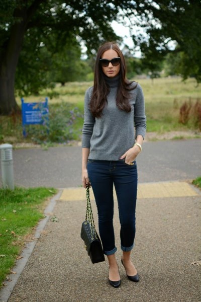 gray suede cashmere sweater with dark blue cuffed skinny jeans