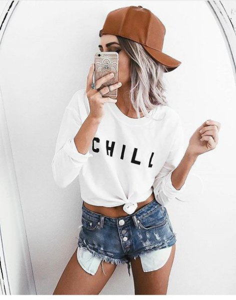 white knotted long sleeve t-shirt with high waisted distressed shorts