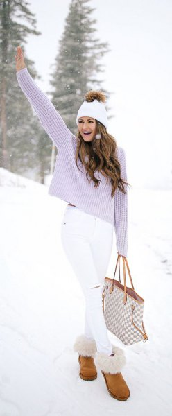 lavender torn sweater with white skinny jeans