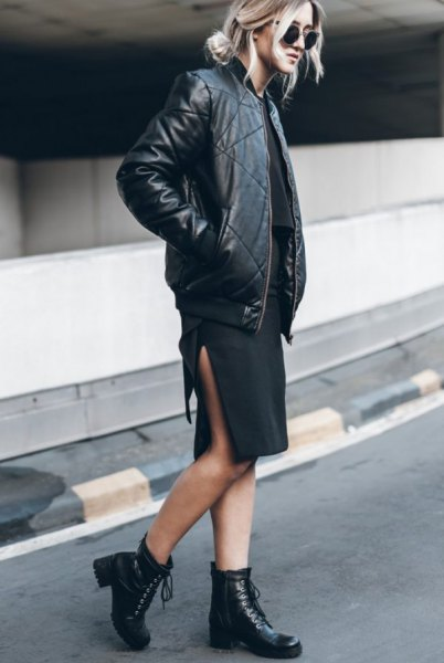 black leather fly jacket with dress with high slit at the knee