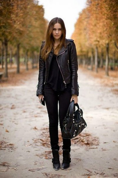 black leather riding jacket with scoop neck and skinny jeans