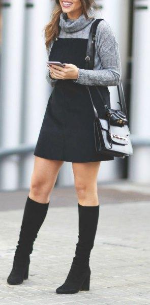 gray turtleneck sweater black pinafore dress