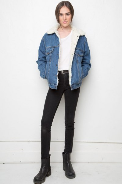 blue sherpa lined jacket with white tee and black jeans