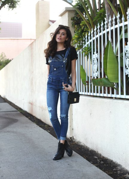 black t-shirt with ripped denim skinny overalls