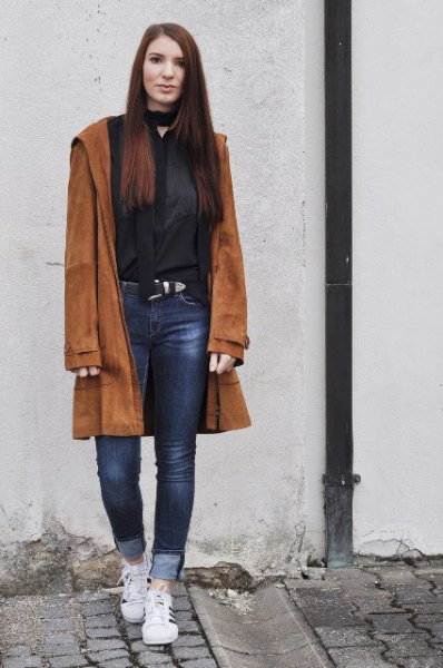 brown suede with black choker neck blouse and cuffed jeans