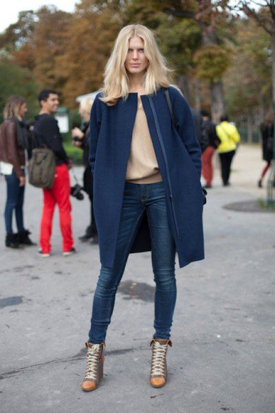 navy blue wool long jacket with pink sweater and super skinny jeans
