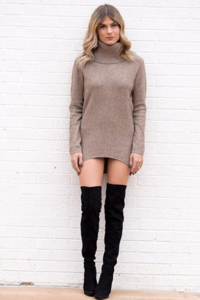 gray turtleneck tunic with black thigh high boots
