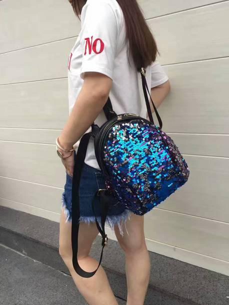 bag, backpack, purse, shoulder bag, t-shirt, shorts, short, outfit .