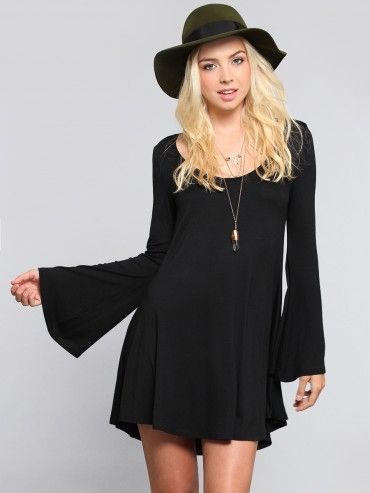 Super soft jersey dress featuring long bell sleeves and a flowy .