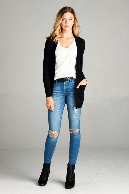 The black cardigan is a closet staple. I love this one because .