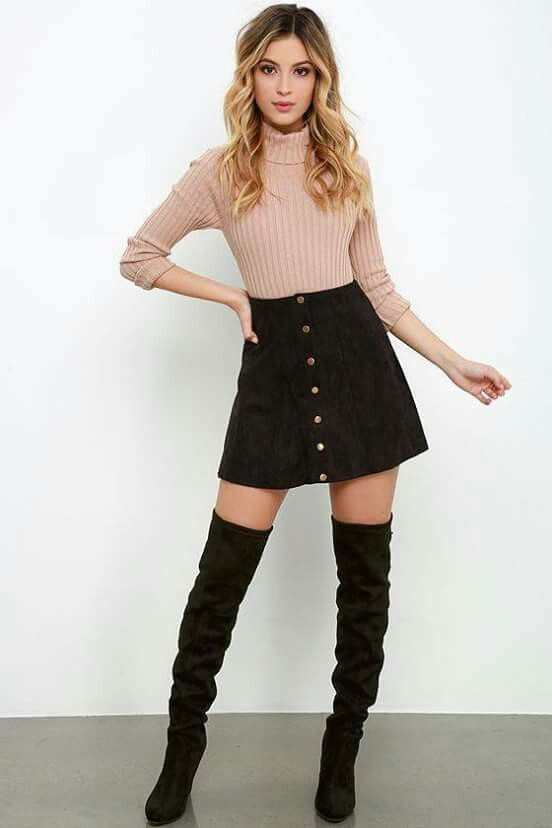 Pink turtleneck + black corduroy skirt + black over the knee boots .