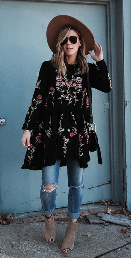 A Black Embroidery Dress inspired by the latest boho chic fashion .