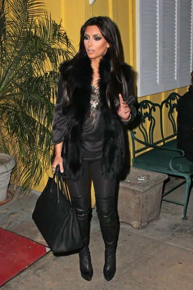 celeberties and big fur | Kim%2BKardashian%2Bblack+faux+fur+vest .