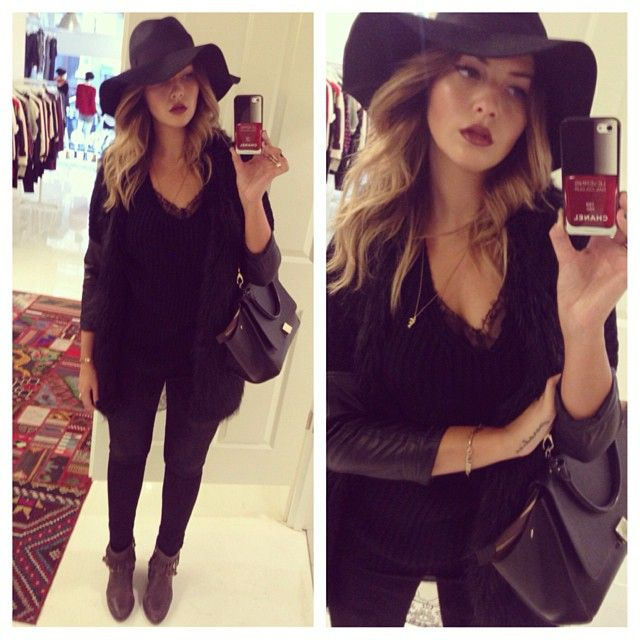 Sophisticated all-black outfit with an adorable black floppy hat .